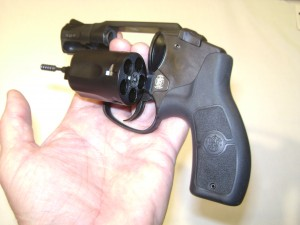 Double action only revolver with cylinder open. Ammunition goes in the holes (chambers) in the cylinder